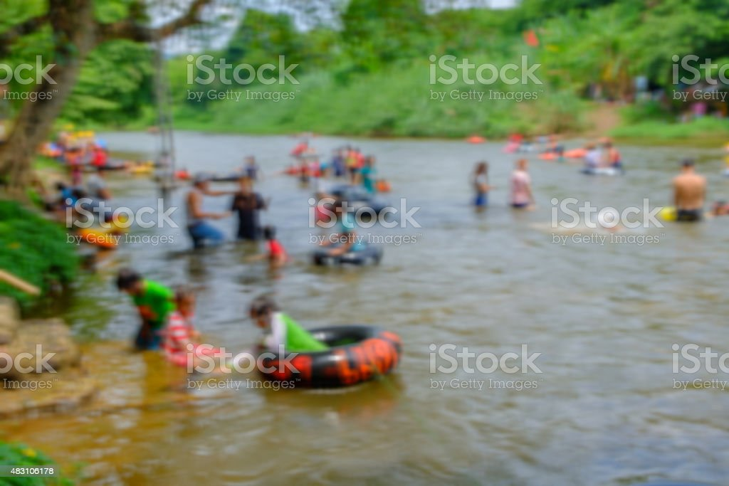 Blured people were swimming in the summer. stock photo