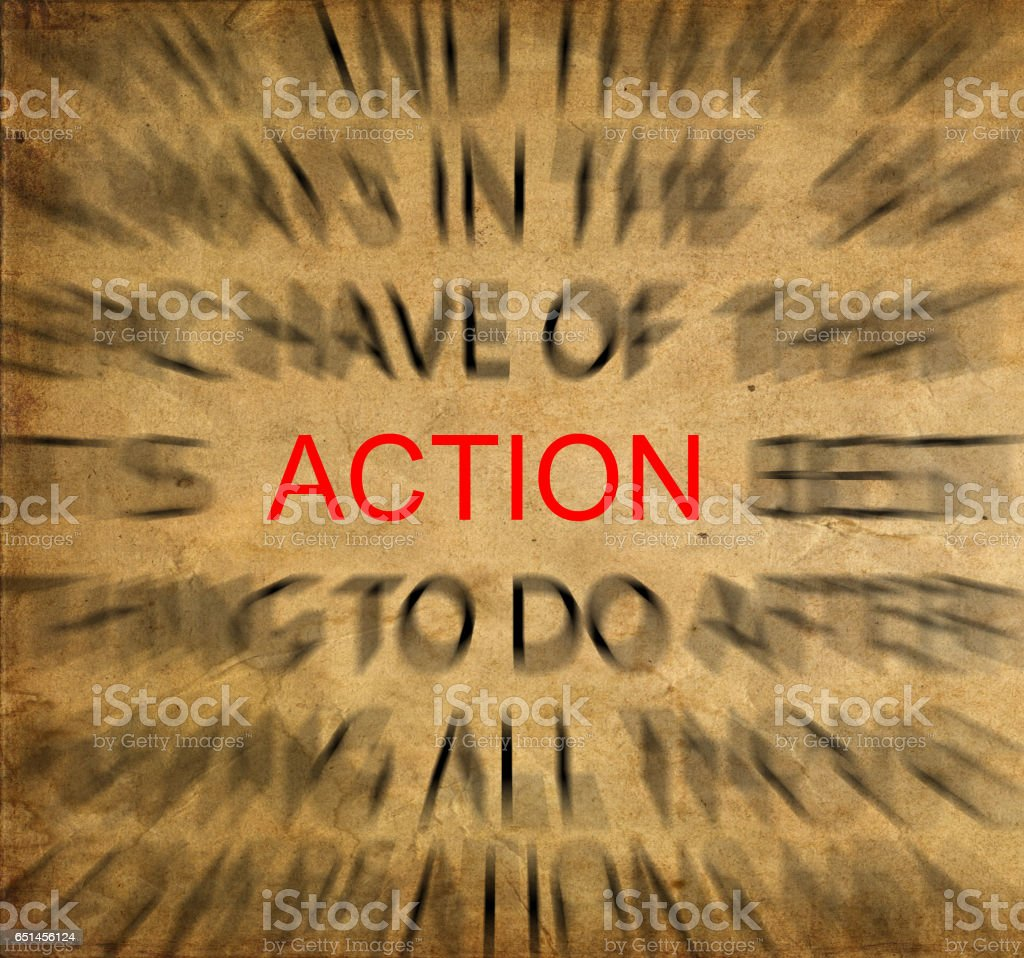 Blured text on vintage paper with focus on ACTION stock photo