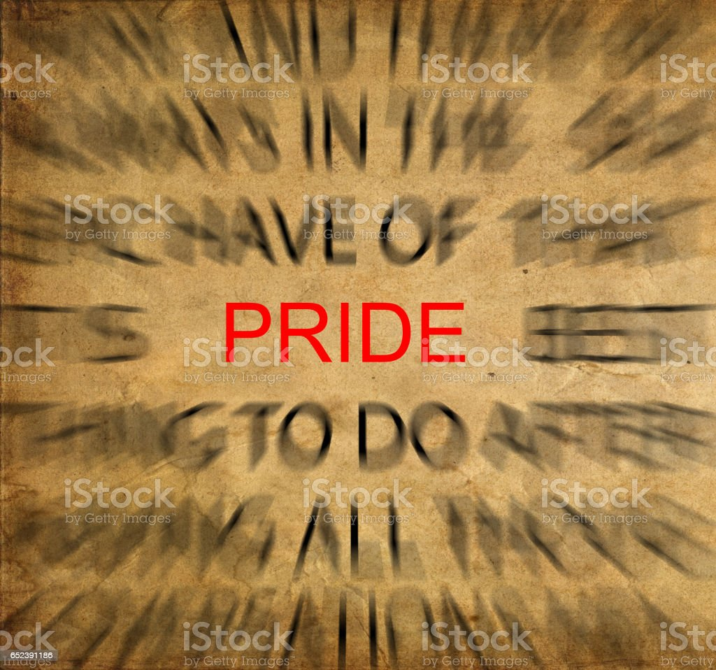 Blured text on vintage paper with focus on PRIDE stock photo