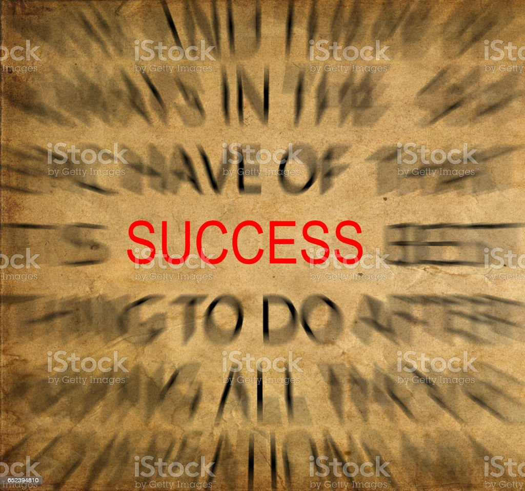 Blured text on vintage paper with focus on SUCCESS stock photo