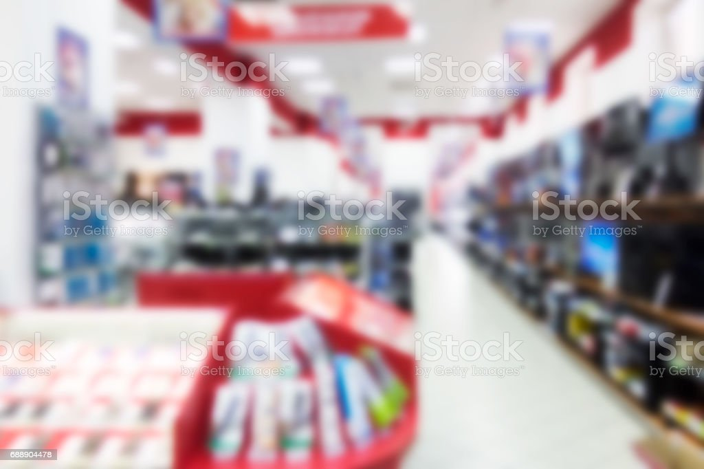 A blurred abstract background can be an illustration to an article about shopping malls and the sale of digital technology stock photo