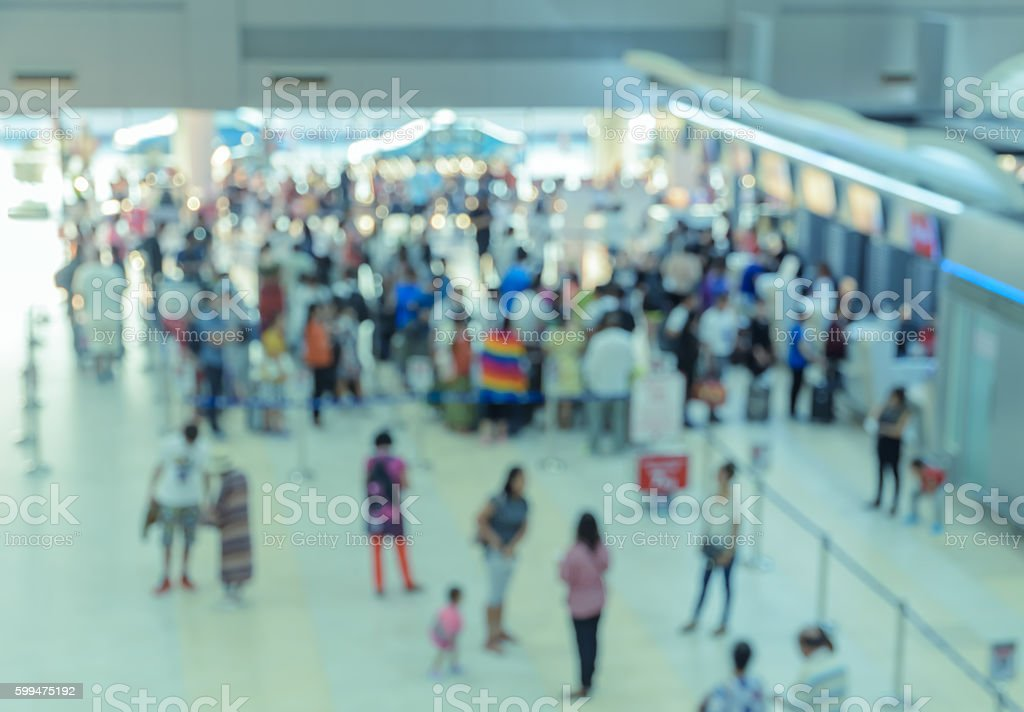 Blurred abstract  passengers at airport check-in hall stock photo