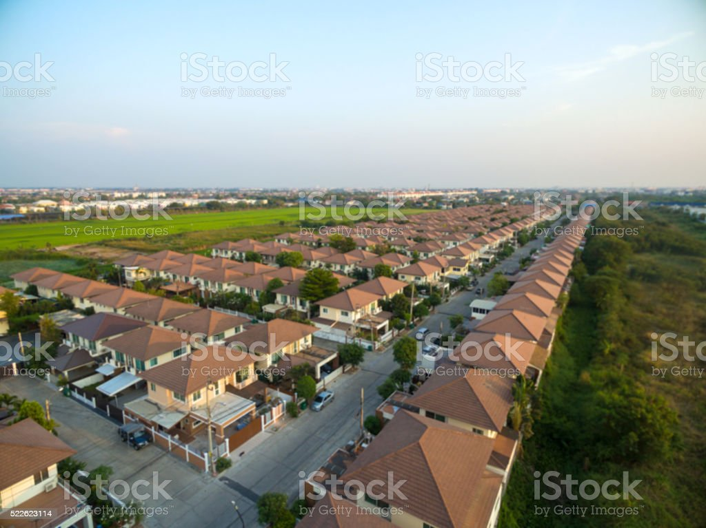 blurred Aerial view above Housing Estate stock photo