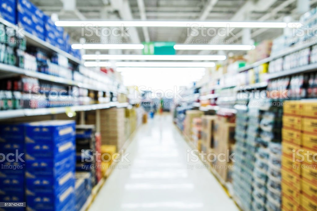 Blurred aisle in supermarket stock photo
