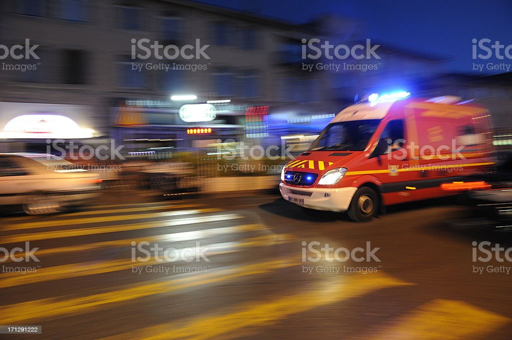 Blurred ambulance racing through the streets of Marseilles stock photo