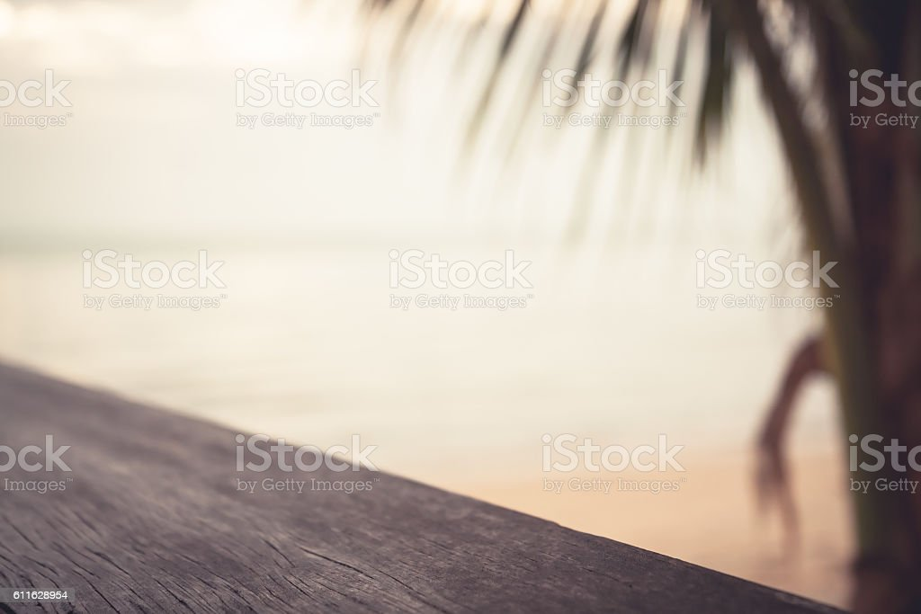 Blurred and defocused tropical beach background with palm tree at...