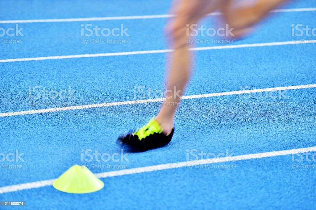Blurred athlete on the sprint track stock photo
