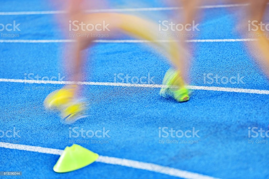 Blurred athletes on the sprint track stock photo