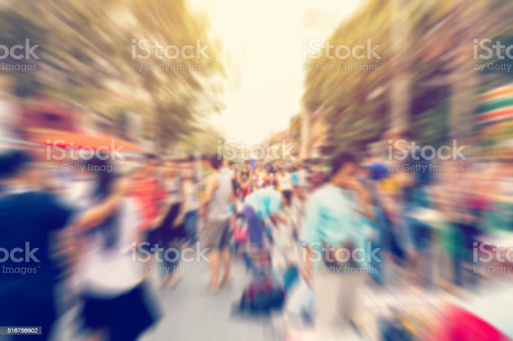 Blurred background. Blurred people walking through a city street stock photo