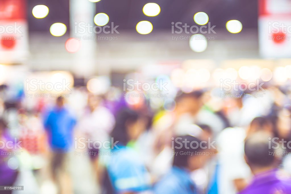 Blurred background : crowd of people in expo fair stock photo