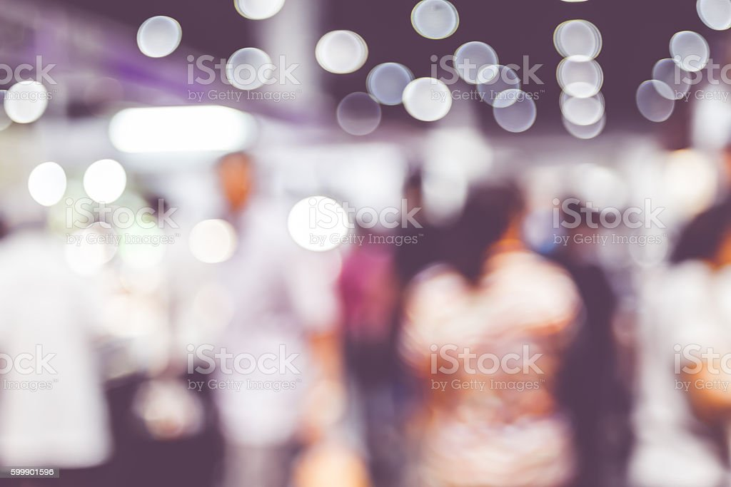 Blurred background: crowd of people in expo fair with bokeh stock photo