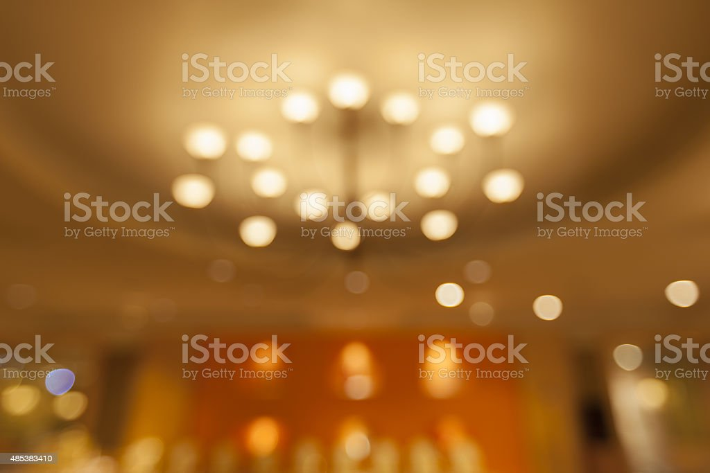 Blurred Background - Electric lamp on ceiling bokeh. stock photo