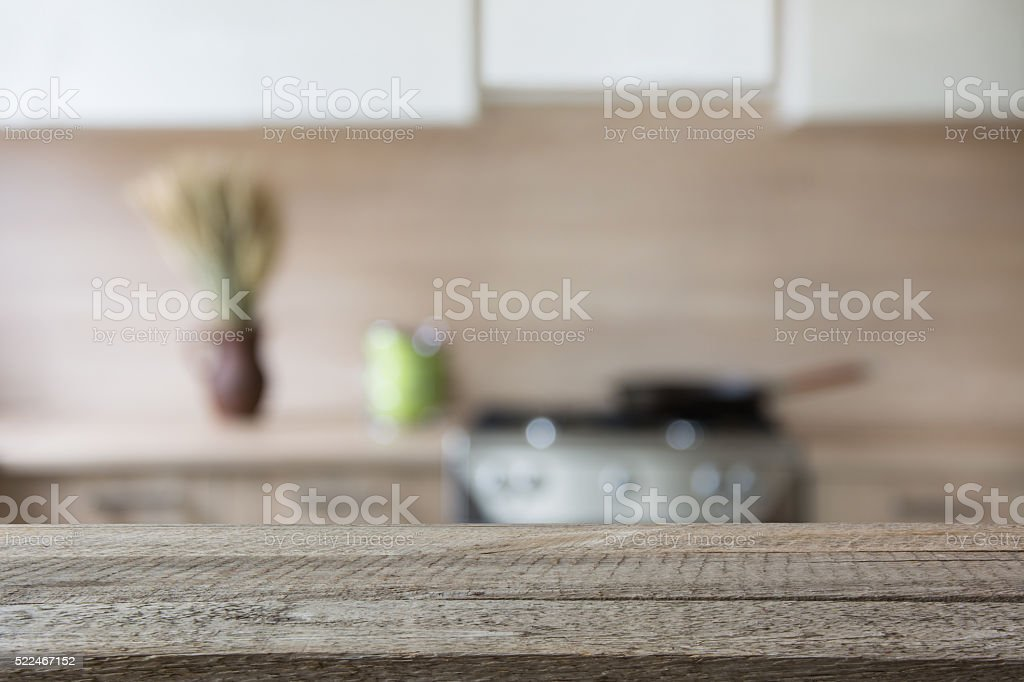 Blurred background. Modern kitchen with tabletop and space for you. stock photo