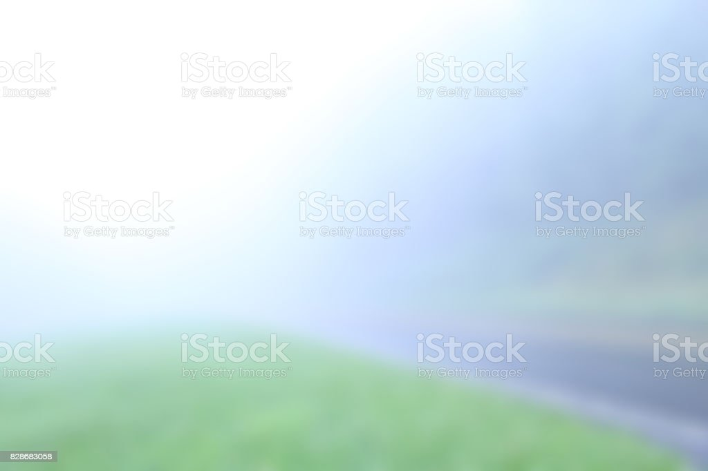Blurred Background of Misty Road in the Mountains stock photo