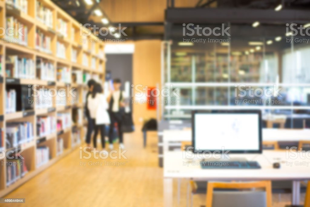 Blurred background of modern library with bookshelves stock photo