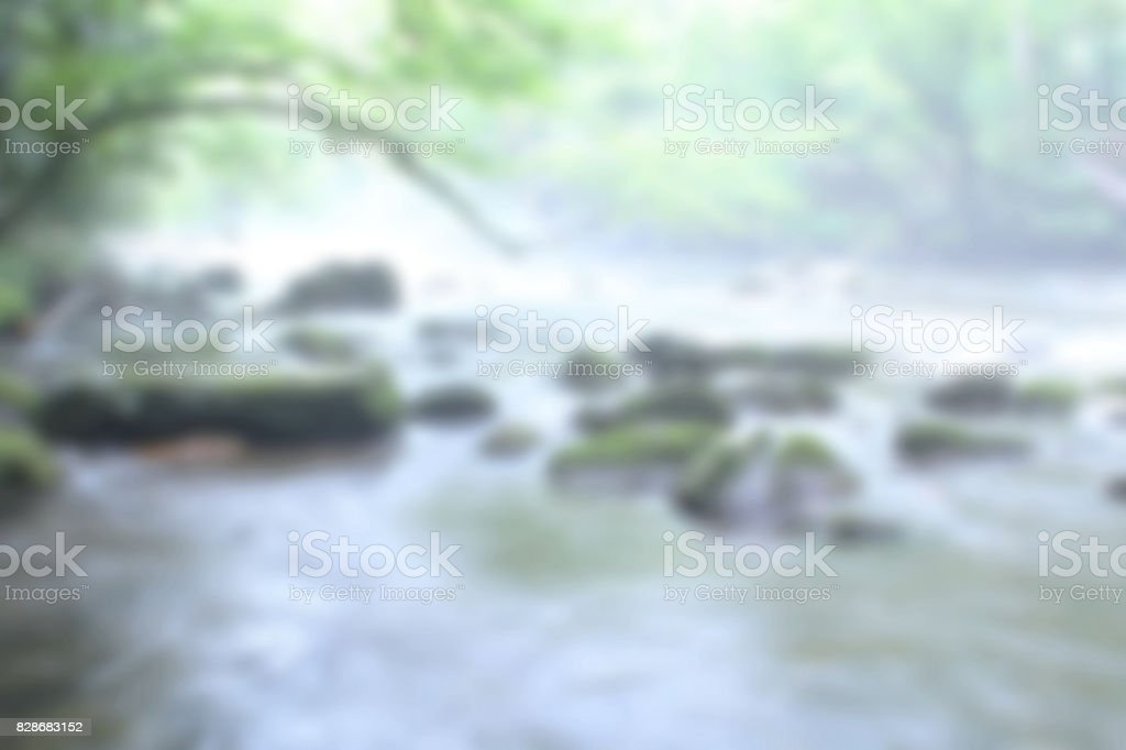 Blurred Background of Natural River with Rocks stock photo