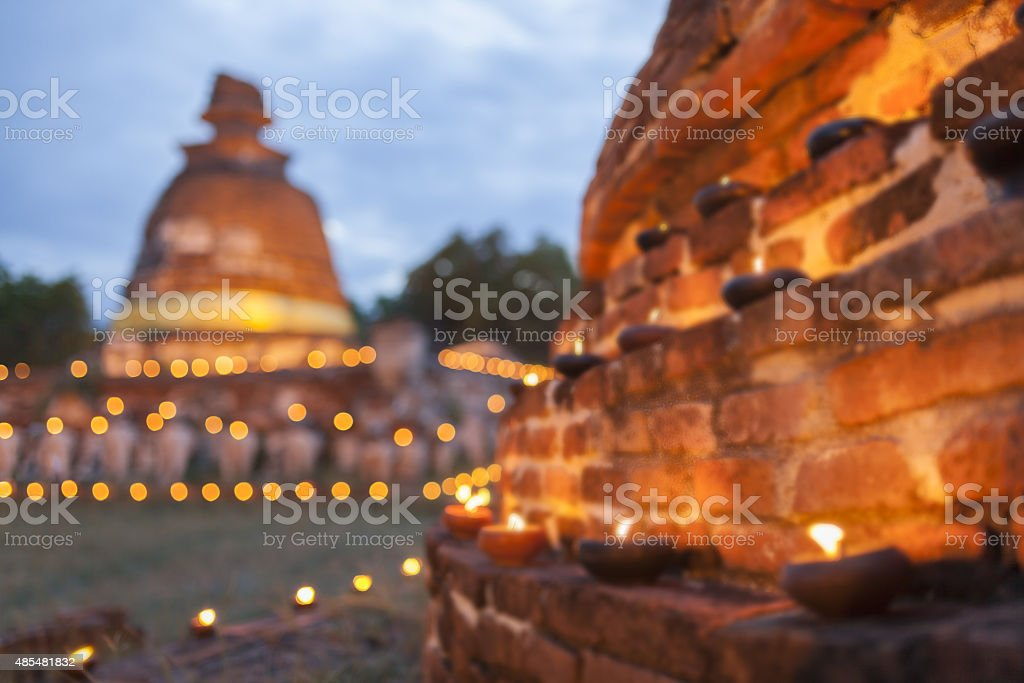 Blurred background of Old pagoda with oil lamp stock photo