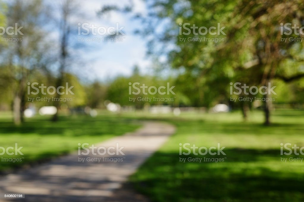 blurred background of spring or summer park in town stock photo