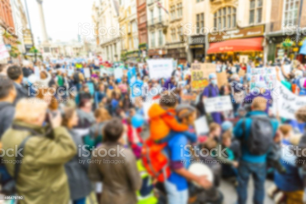Blurred background of thousands people marching in London stock photo
