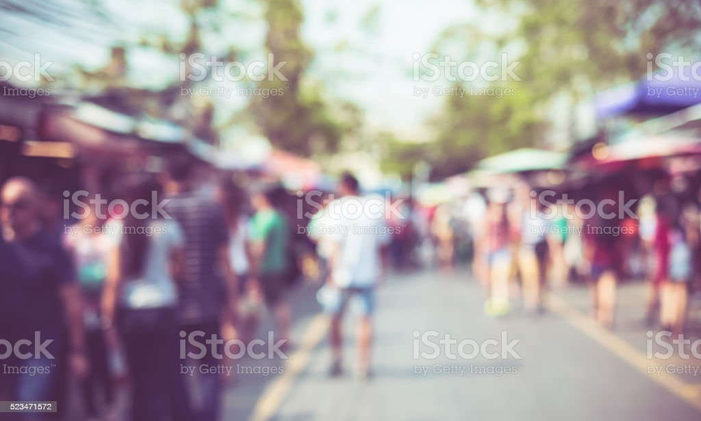 Blurred background : people shopping at market fair stock photo