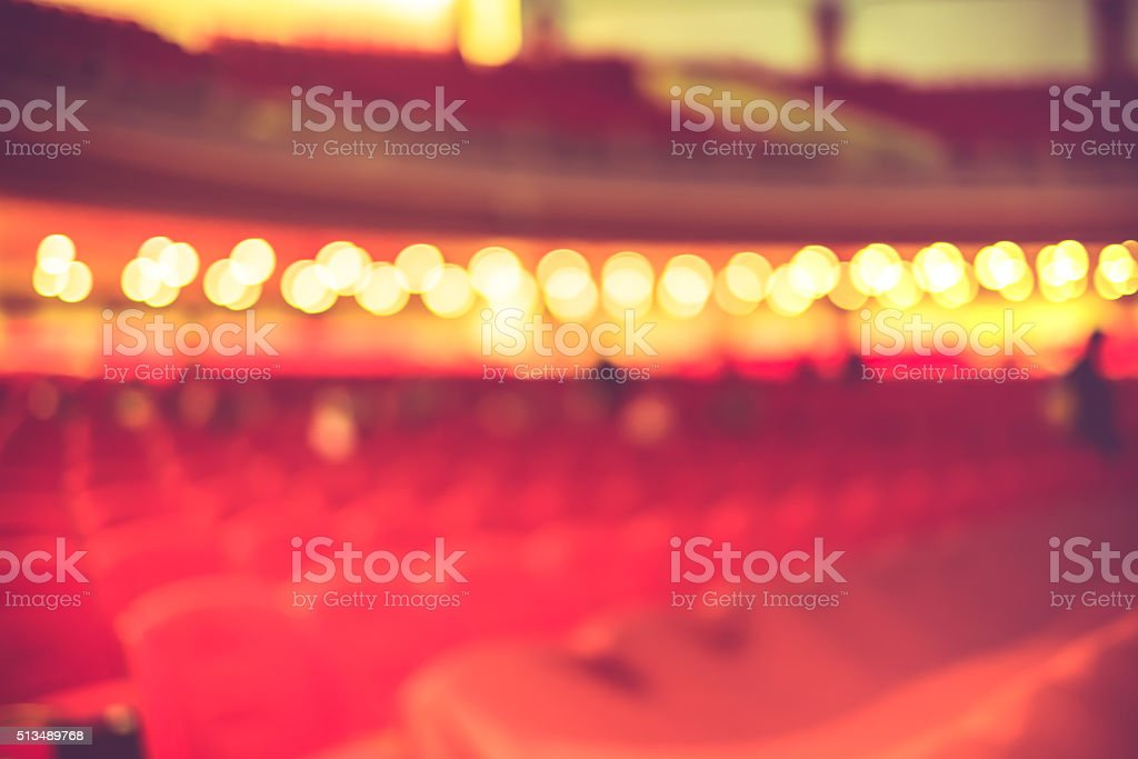 Blurred background, Red seat row in theatre with vintage filter stock photo
