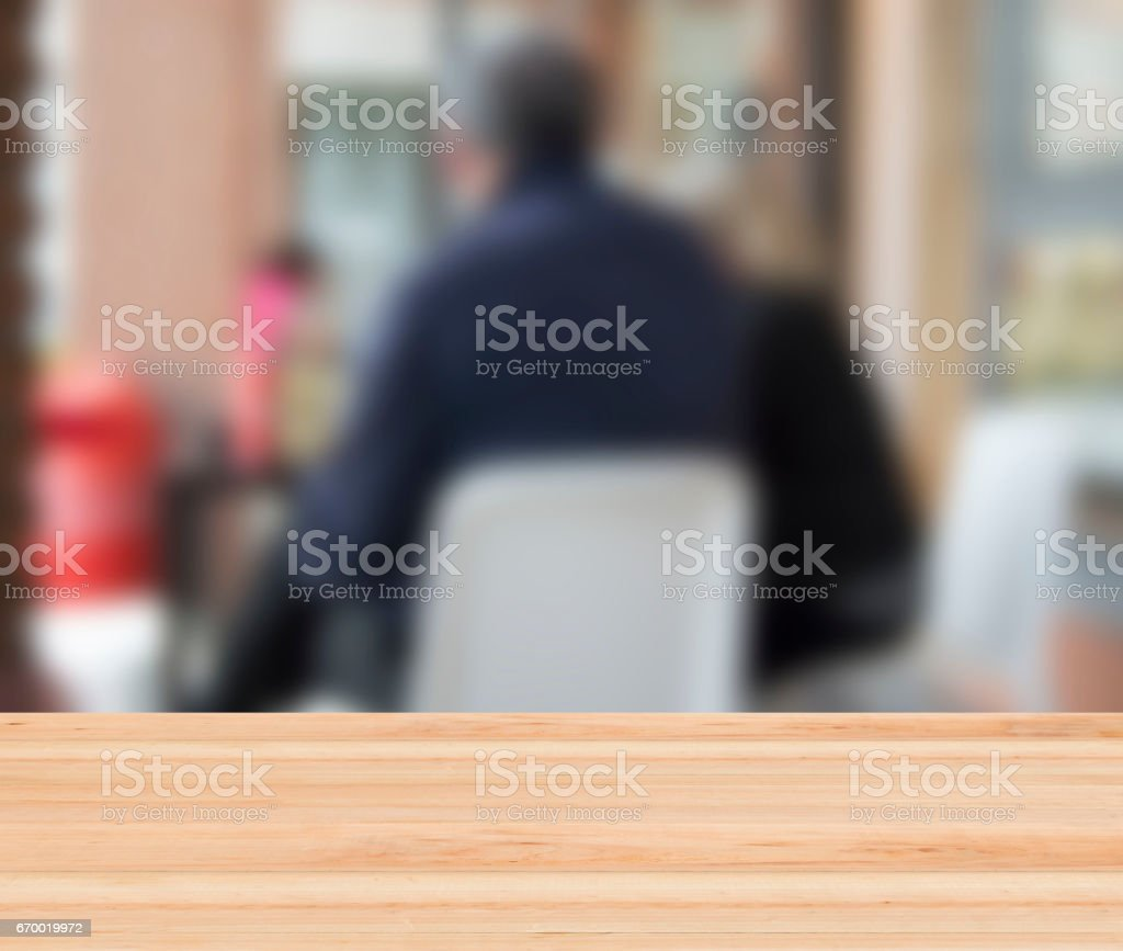 blurred background with people sitting at the bar stock photo