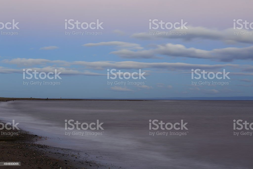 Blurred beach at dramatic sky sunset cloudscape stock photo