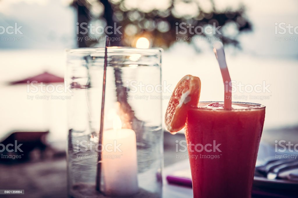 blurred beach holidays  background with cocktail and candle stock photo