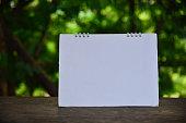 Blurred blank calendar page.