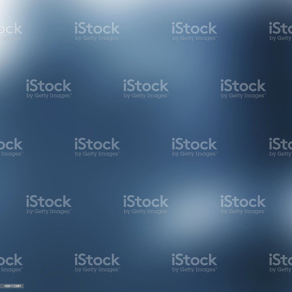 A blurred blue background with some white spots stock photo