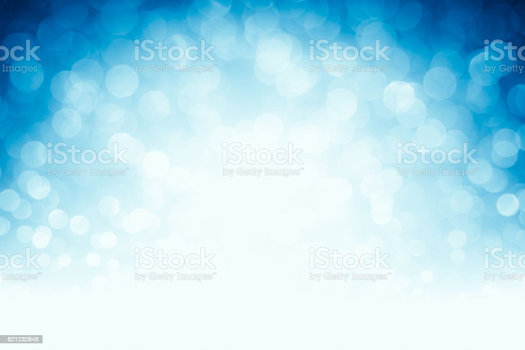 Blurred blue defocused lights and sparkles background stock photo