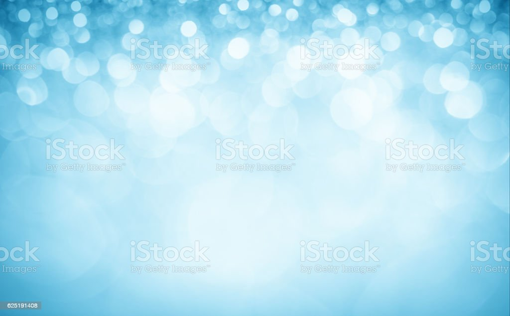 Blurred blue sparkles and glitters stock photo