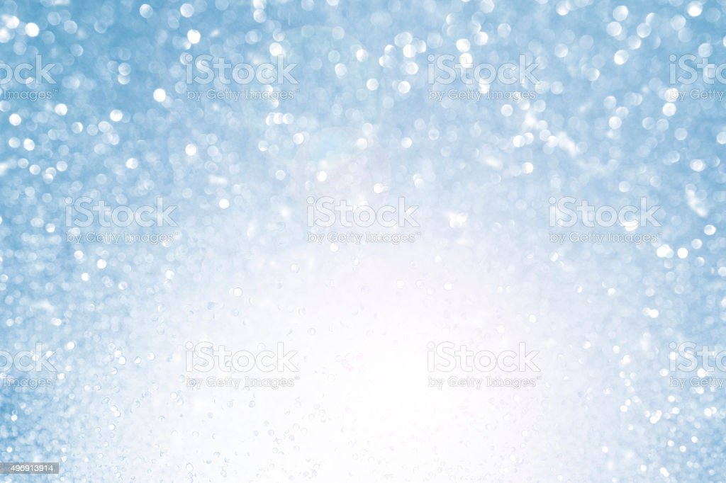 Blurred blue sparkles background bokeh stock photo