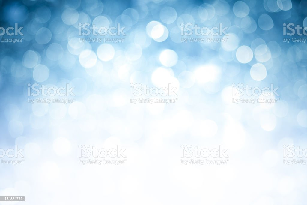 Blurred blue sparkles background with darker top corners stock photo