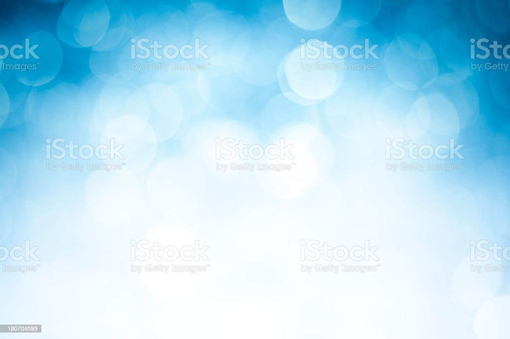 Blurred blue sparkles on white stock photo