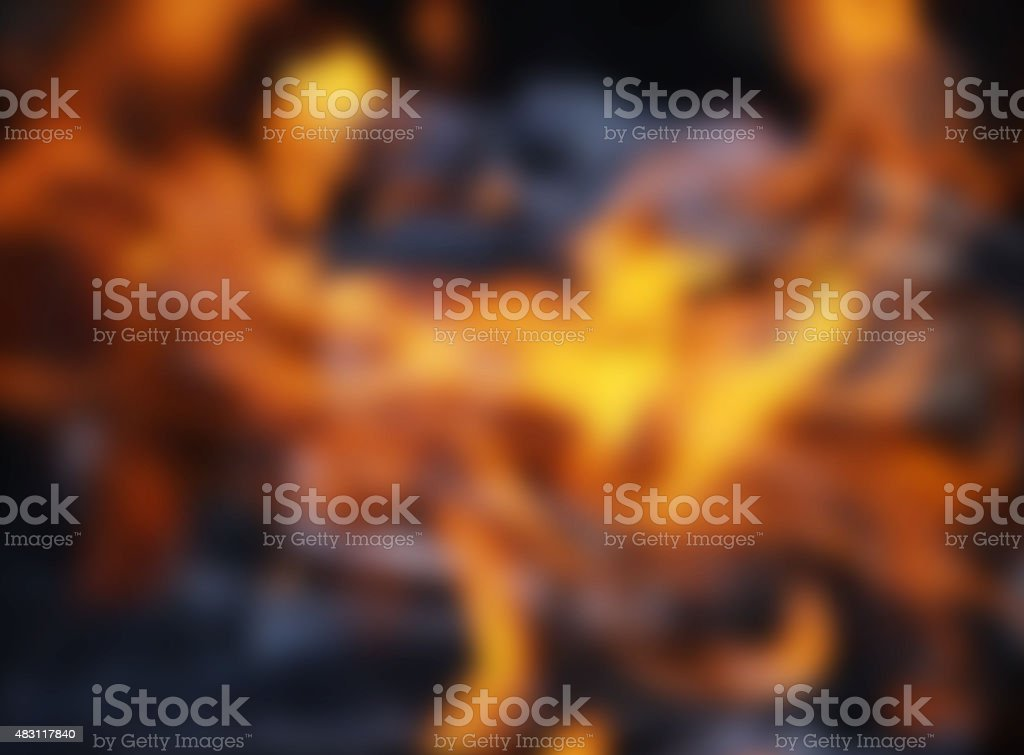 Blurred burning charcoal embers firewood with ashes and flames stock photo