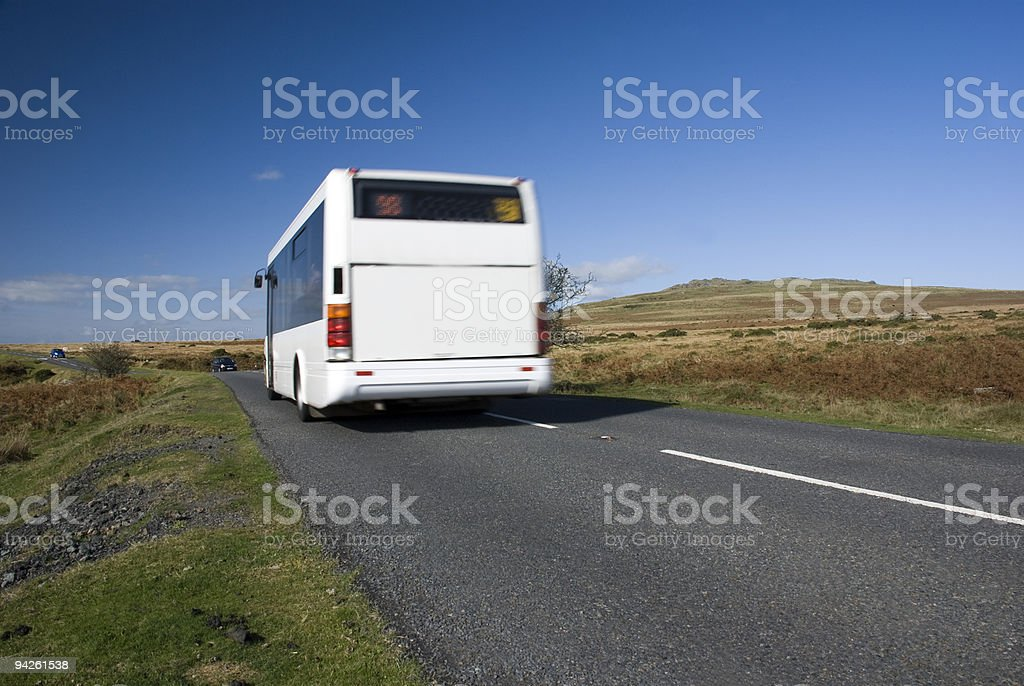 Blurred bus on rural road royalty-free stock photo