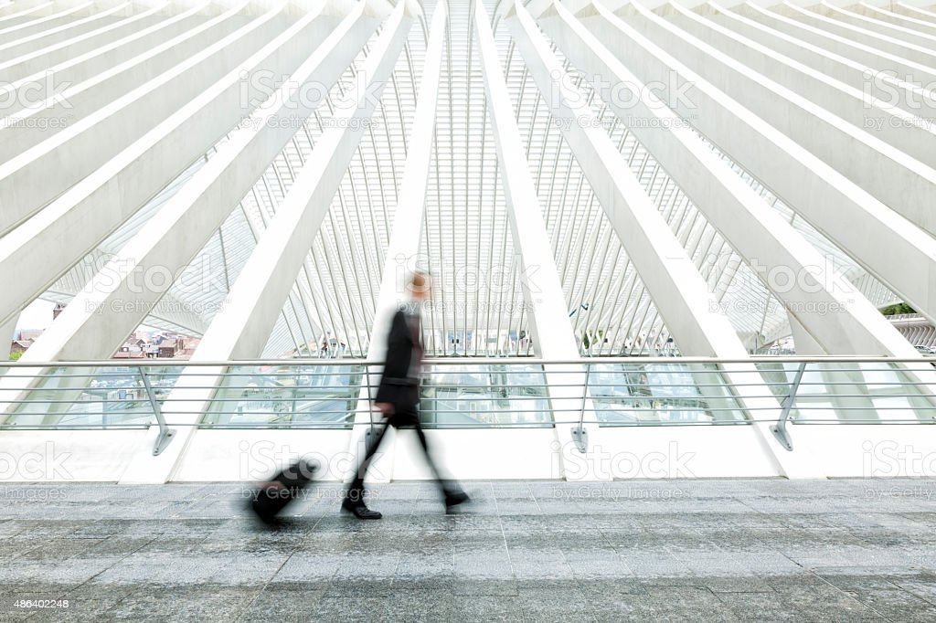 Blurred Business Commuter Walking in Modern Station stock photo