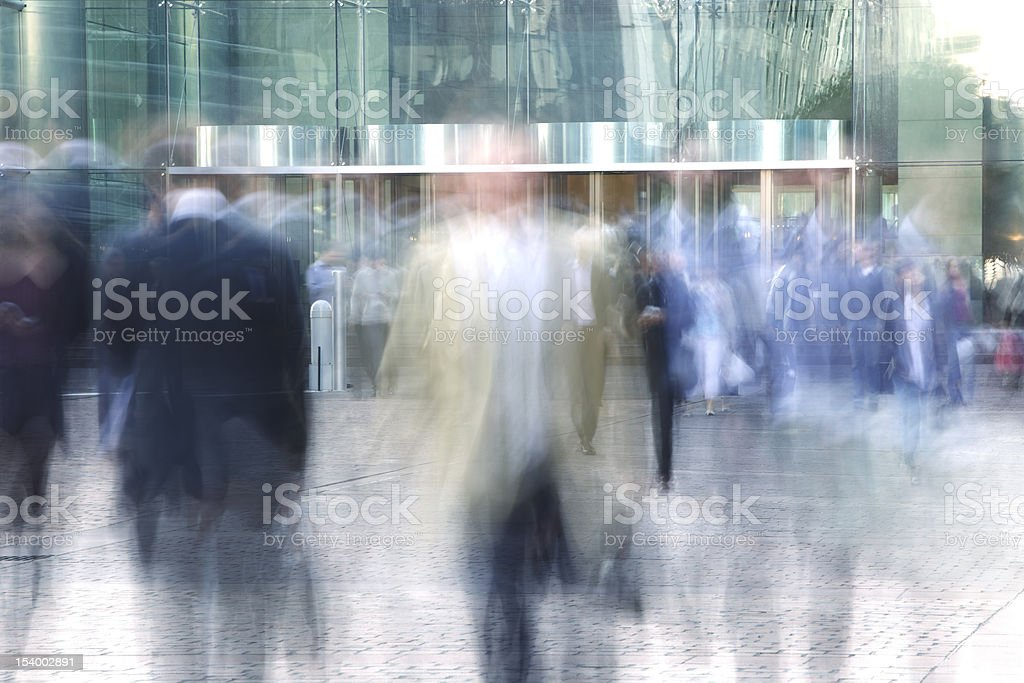 Blurred Business People Entering and Leaving Office Building royalty-free stock photo