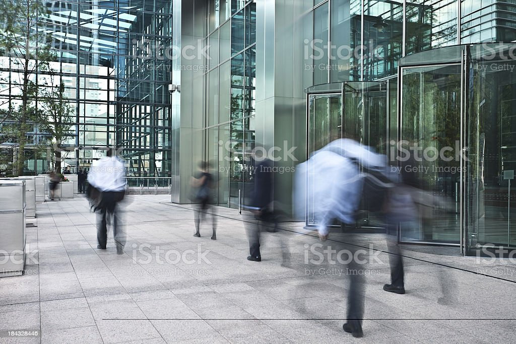 Blurred Business People Walking Fast in Financial District royalty-free stock photo