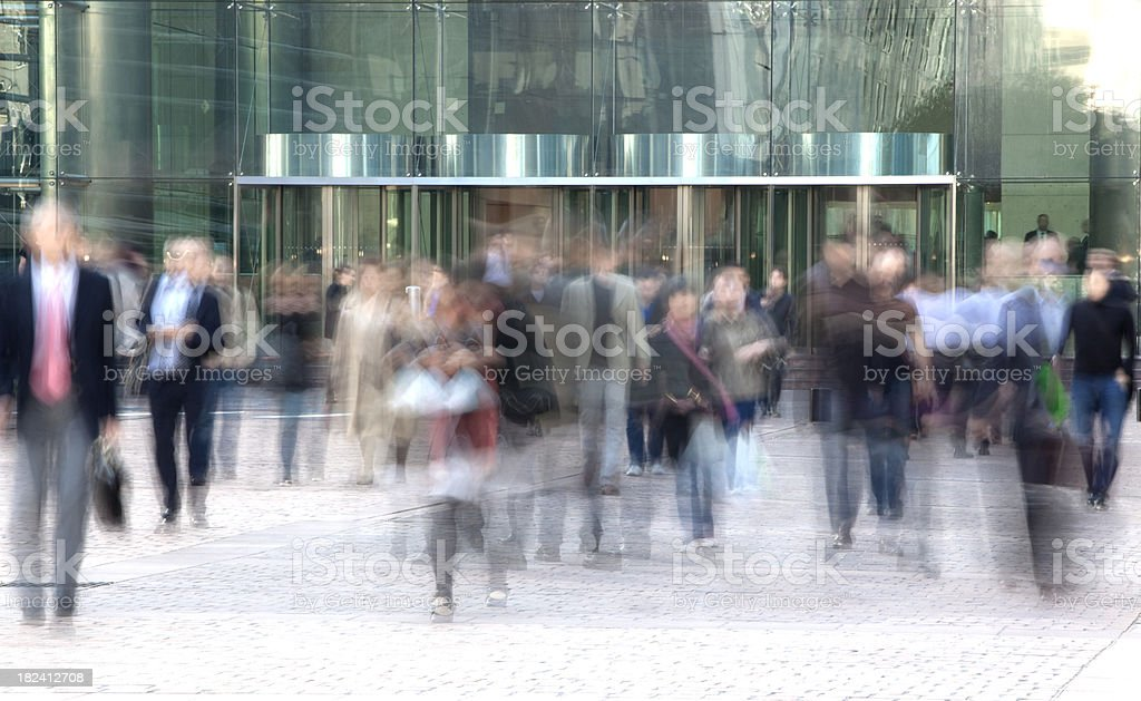 Blurred business people walking fast royalty-free stock photo