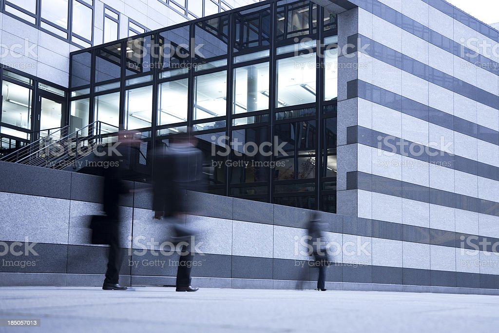 Blurred Business People  Walking Past Striped Wall royalty-free stock photo