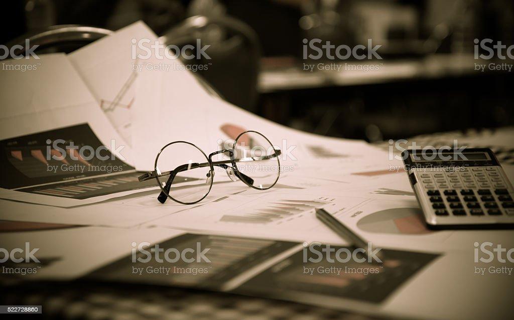 Blurred business work space in Dark tone. stock photo