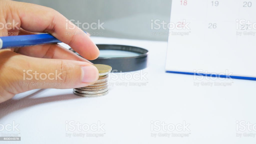 Blurred calendar in white tone close up hand marking. stock photo