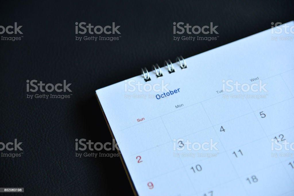 Blurred calendar on black background. stock photo