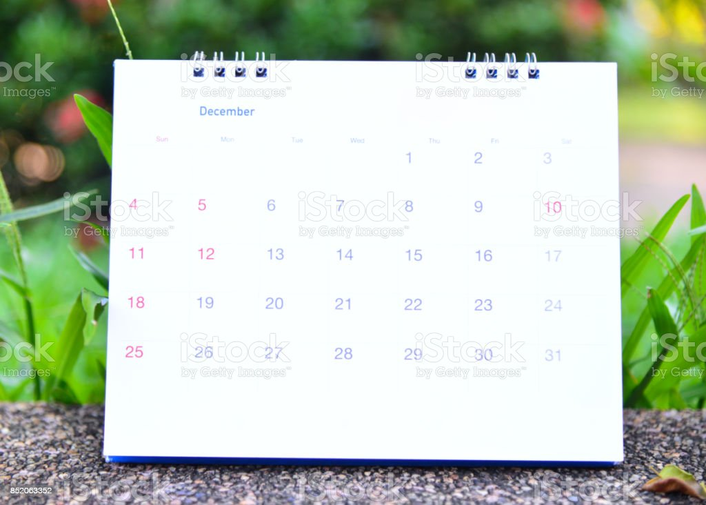 Blurred calendar on green nature background. stock photo