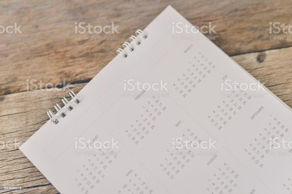 Blurred calendar on wood texture. stock photo