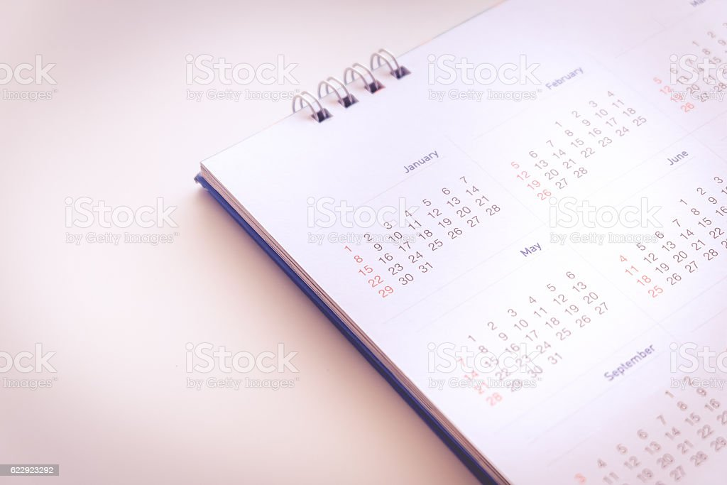 Blurred calendar page in pink  tone stock photo
