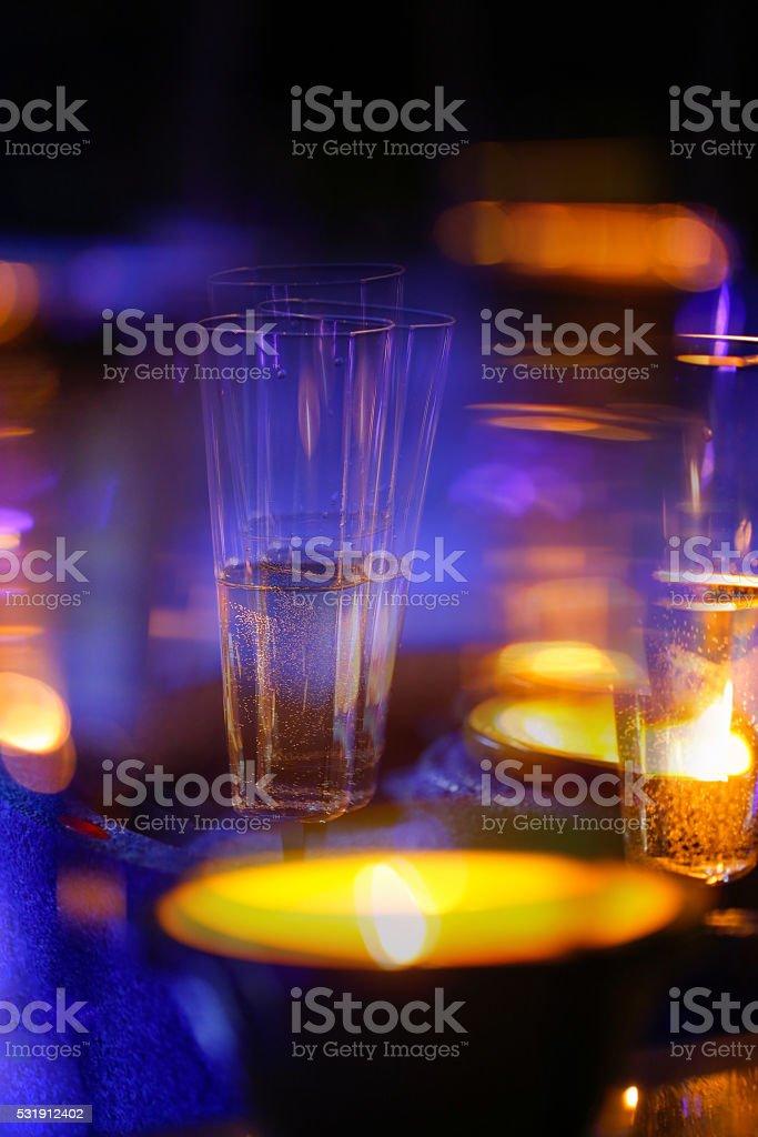 Blurred candlelit champagne glasses stock photo