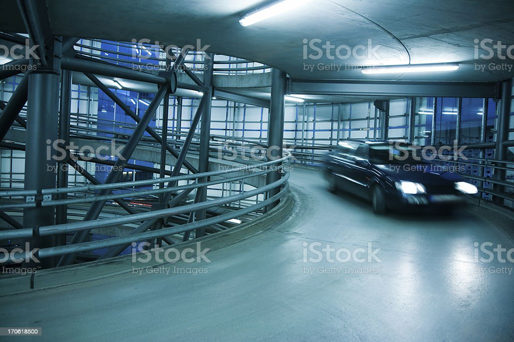 Blurred Car in Spiral Exit From a Parking Garage royalty-free stock photo